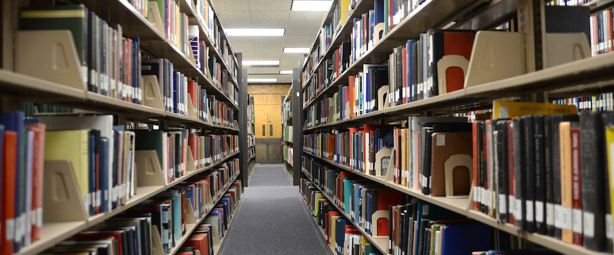 A photo of book stacks at an NEIU library