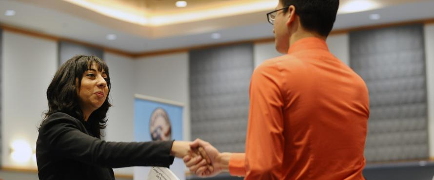 Photo of student meeting an employer at a job fair.