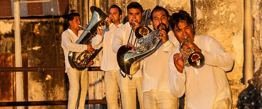 M5 Mexican Brass Band members playing brass instruments