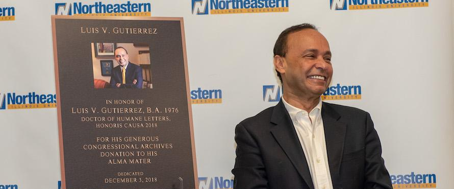 Luis Gutierrez smiles in front of the mock-up of his plaque.
