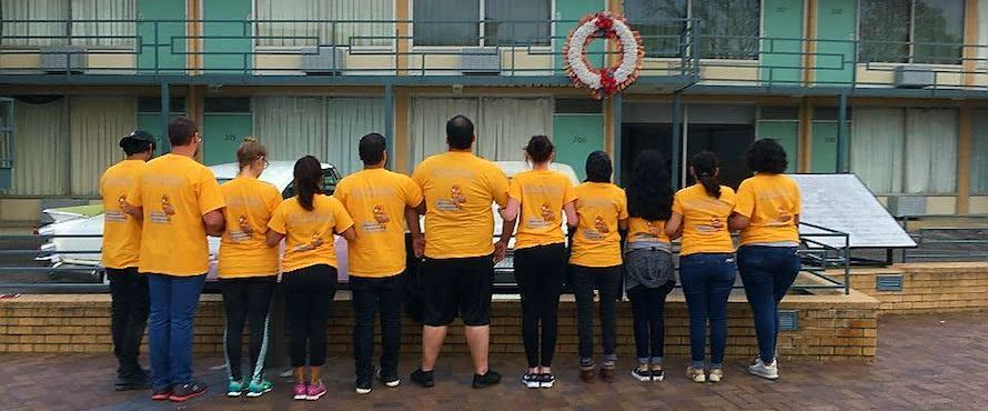 Northeastern students wore yellow NEIU shirts on a 2017 Alternative Spring Break trip while standing outside the National Civil Rights Museum in Memphis, Tenn., looking at the balcony where Dr. Martin Luther King Jr. was shot.