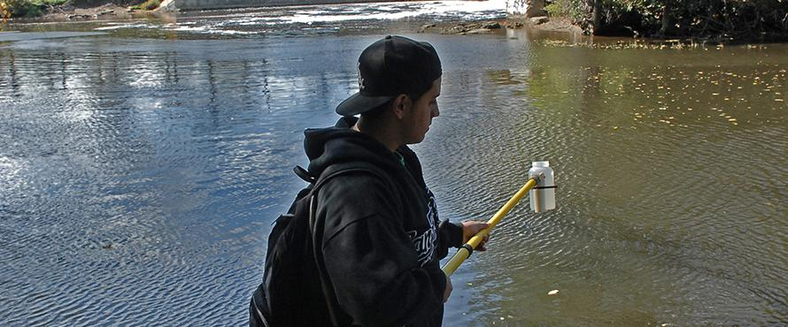 Earth Science student taking water samples