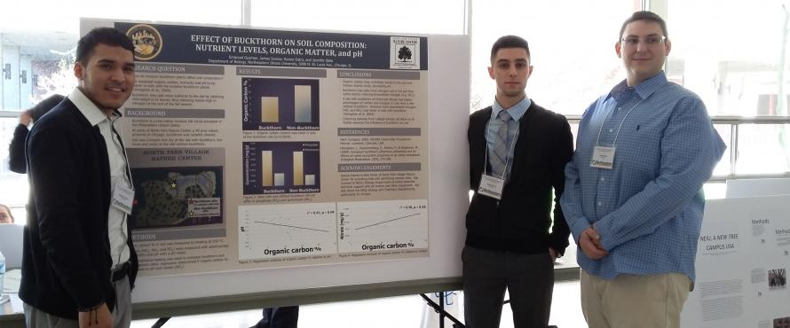 Students presenting their undergraduate research project at a scientific conference.