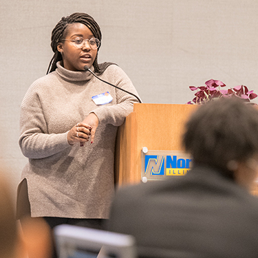 Photo of a woman presenting during a Black student networking meeting in Fall 2019.