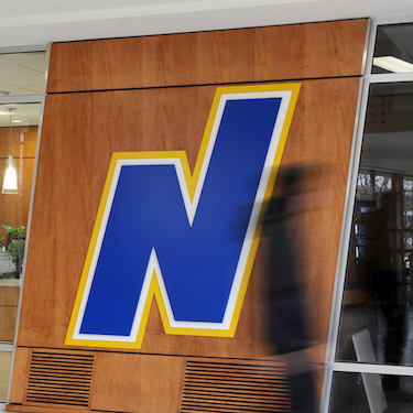 NEIU's flying N logo adorns the entrance to the Admissions Office