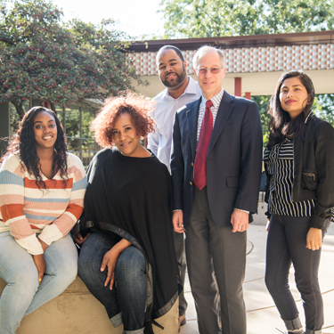 College of Graduate Studies and Research Dean Michael Stern (second from right) poses with DFI Fellows (from left) Candice Graddy, Cherry Blakley, Phillip Lucas and Flor M. Reza.