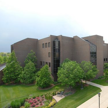An elevated view of the north side of the Ronald Williams Library exterior with the Parking Facility in the background