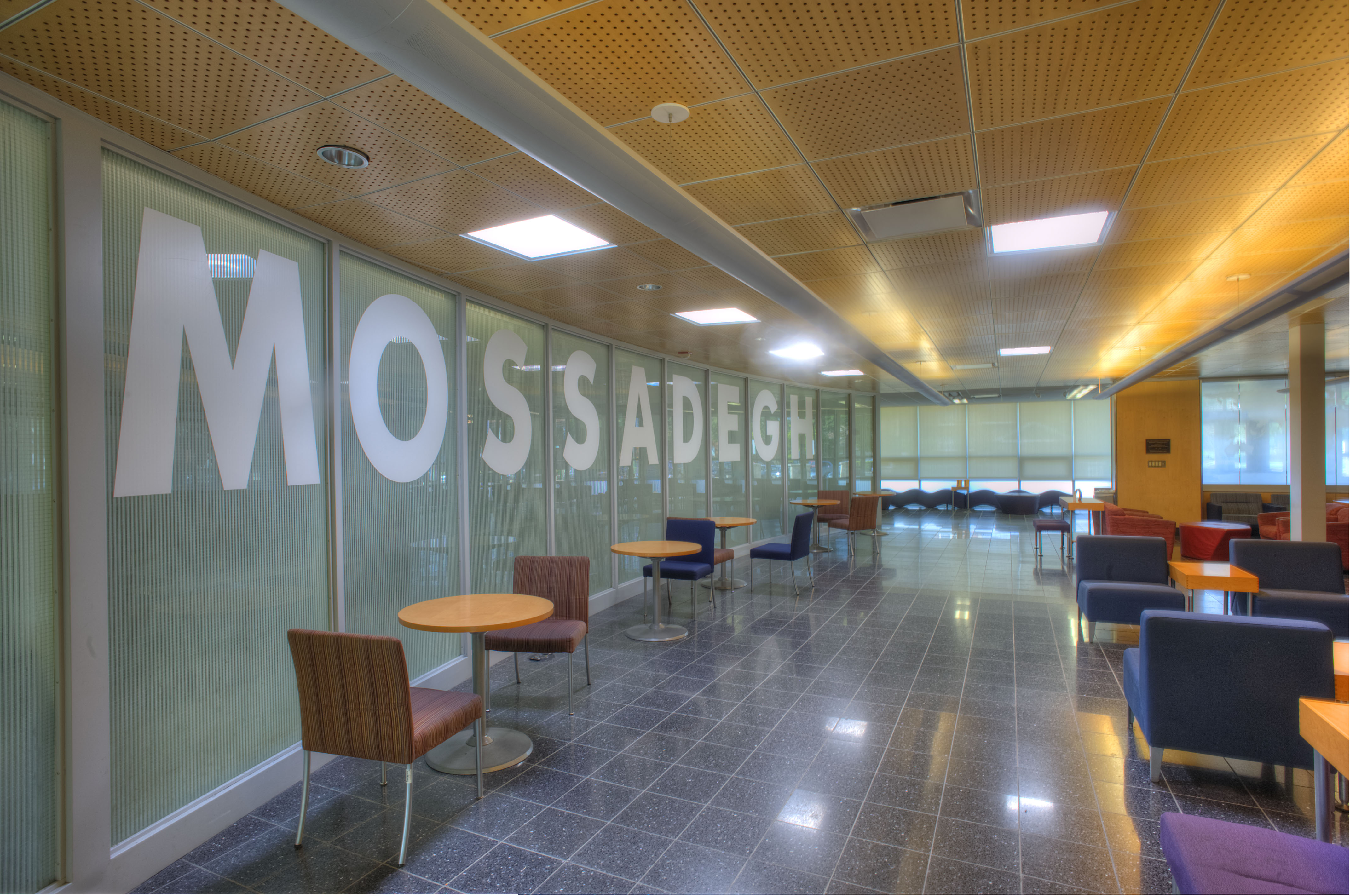 MOSSADEGH spelled out in large capital letters on the windows in Mossadegh Servant Leaders Hall in the College of Business and Management