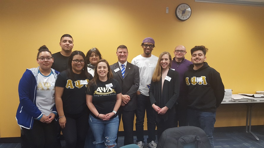 NEIU Alumni Advisory Board President with student attendees