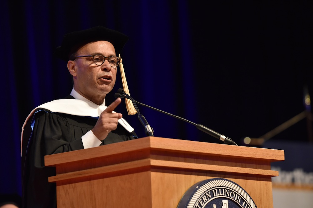 U.S. Congressman Luis V. Gutiérrez addresses the graduates from the podium during Commencement at UIC Pavilion on May 7, 2018.