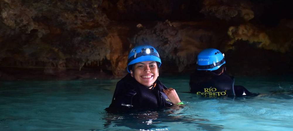 Earth Science junior Andrea Saavedra swims in an underground river as part of her research in Mexico