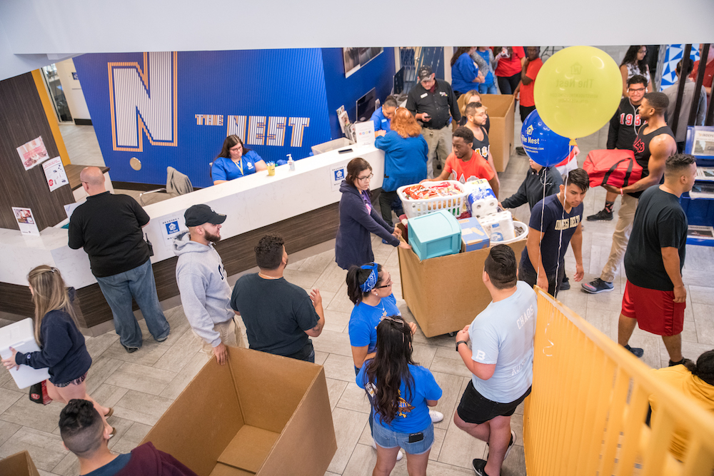 The lobby of The Nest residence hall is packed with students and parents on Move-In Day.