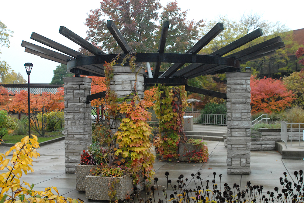 An stylized gazebo in the B Building courtyard in autumn