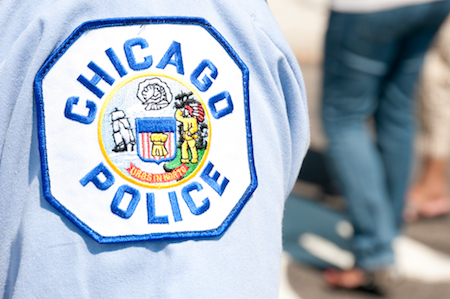 A Chicago Police Department patch is shown on a uniform.