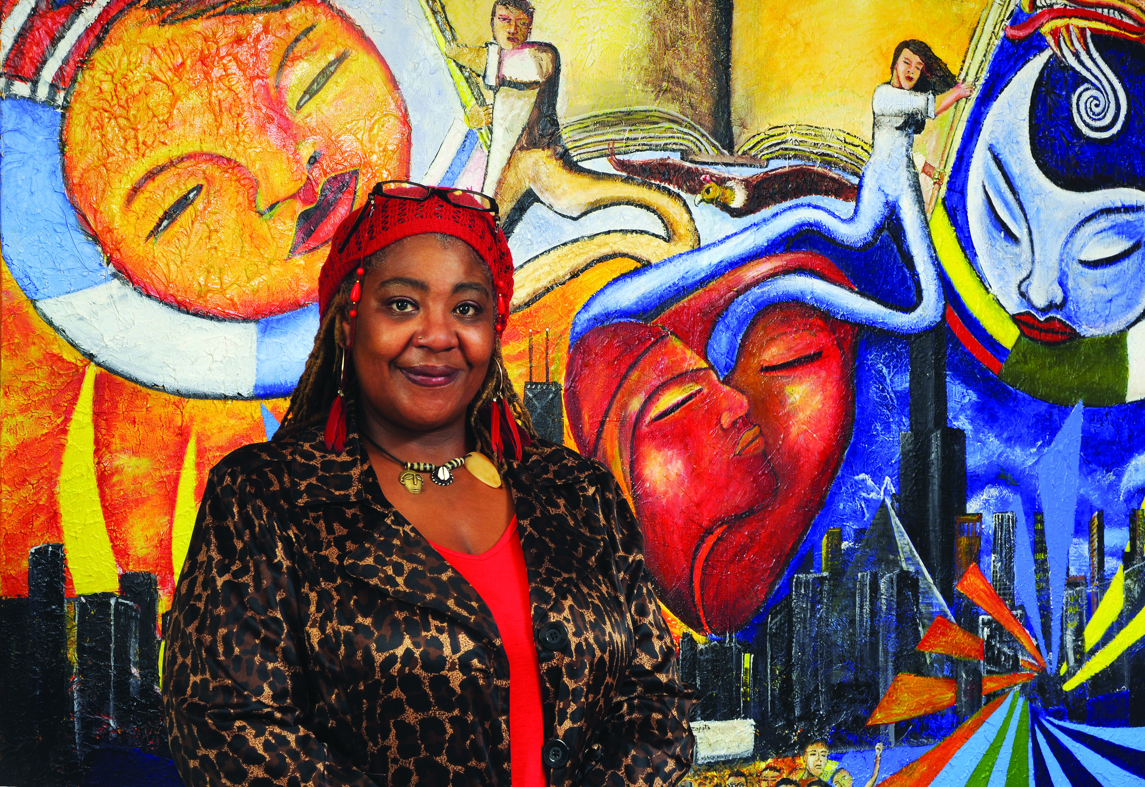 Rachel Hall, NEIUAA Internship Scholarship recipient, poses in front of a colorful mural.