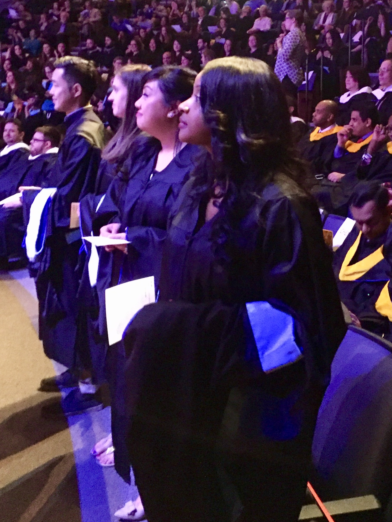 Students standing during the commencement ceremony
