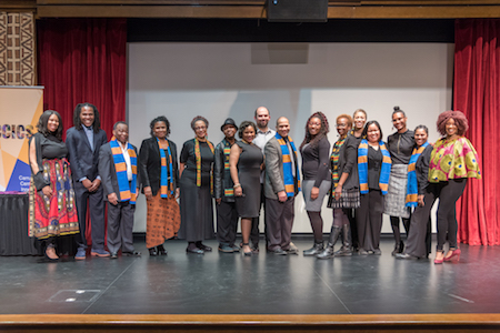 Black Heritage Awards winners pose on stage at the Carruthers Center.