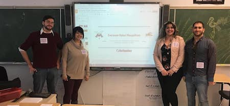 NEIU students Cameo Chilcutt, Michael Konecki, Assil Shawkat and Samah Slim stand in a classroom in front of a projection screen