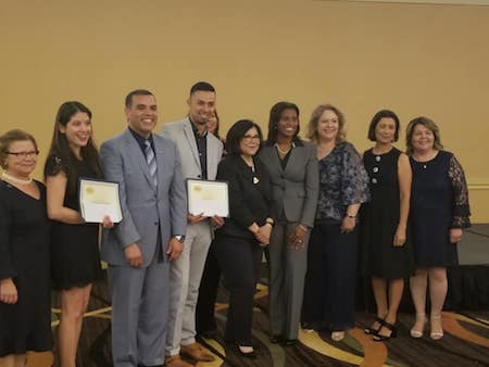 Graduate students Cynthia Bautista and Ken Cuellar stand among 10 recipients of the Principal-On-Training scholarship