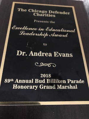 An award plaque presented to Dr. Andrea Evans from the Chicago Defender Charities for Excellence in Educational Leadership