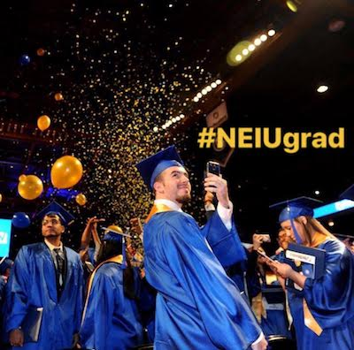 A graduate at Commencement takes a selfie; the hashtag #NEIUgrad is overlaid on the image