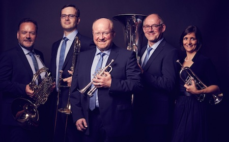 The five members of Harmonic Brass pose holding their instruments