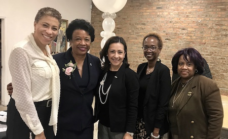 President Gibson (second from left) with (from left) Carruthers Center Director Andrea Evans, Executive Director of Government Relations Suleyma Perez, Director of Scholarships Michelle Morrow and Director of Financial Aid Maureen Amos