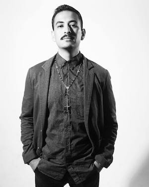 Poet Marcelo Hernandez Castillo faces the camera in this black and white photo