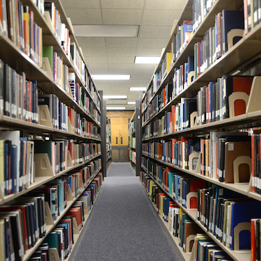 Photo of the book stacks at Northeastern's Ronald Williams Library