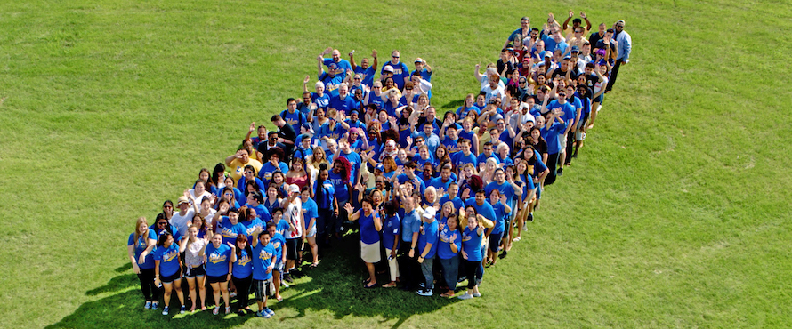 Students, staff, alumni and friends form a giant letter N on the University Commons