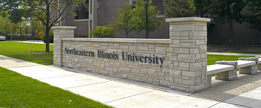 A low wall will Northeastern Illinois University spelled out on it
