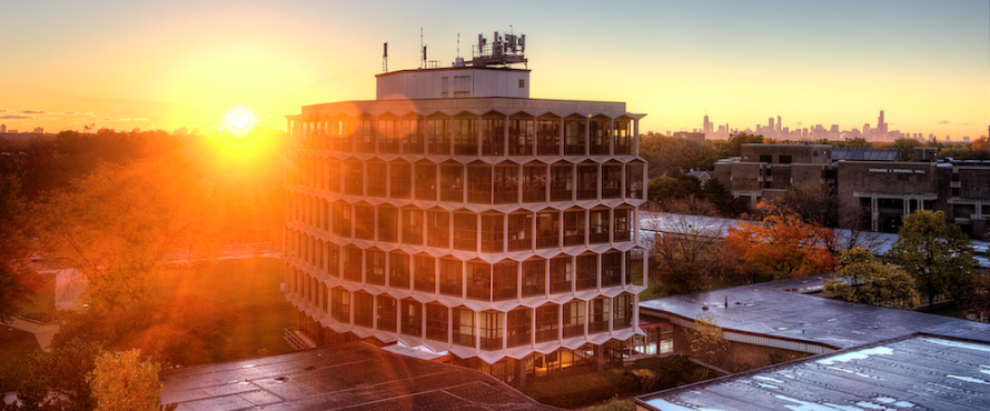 The sun rises behind the Sachs Administrative Building.