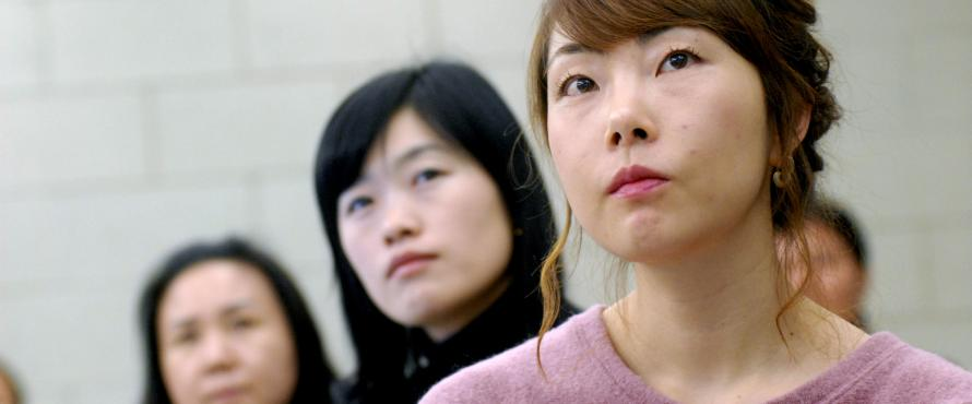 Three female students looking in the same direction