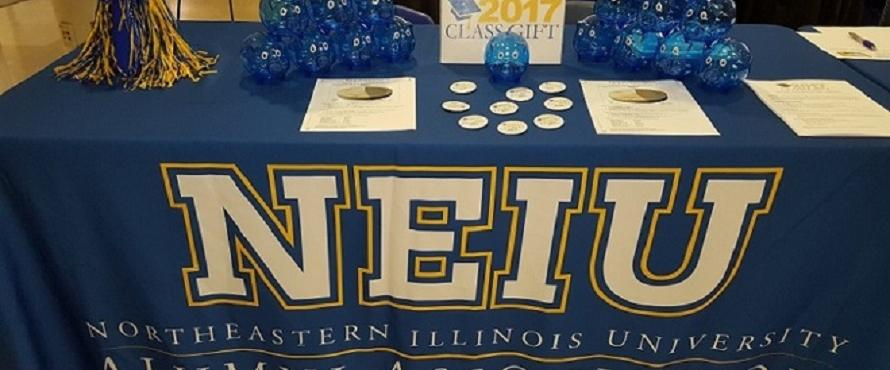NEIU is shown on a blue tablecloth.