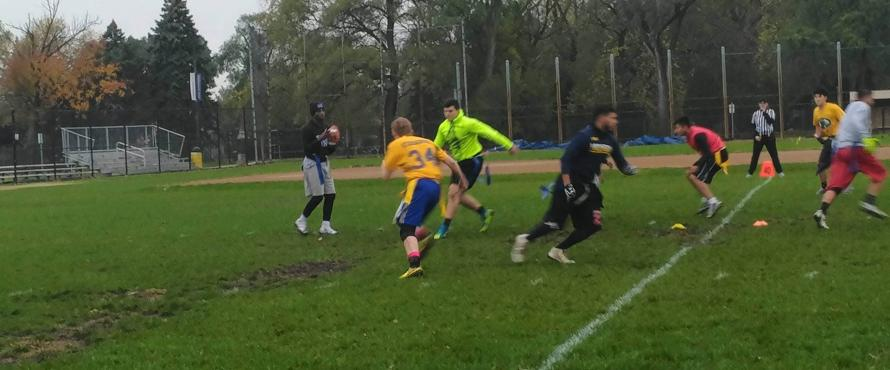 Flag football player throwing football