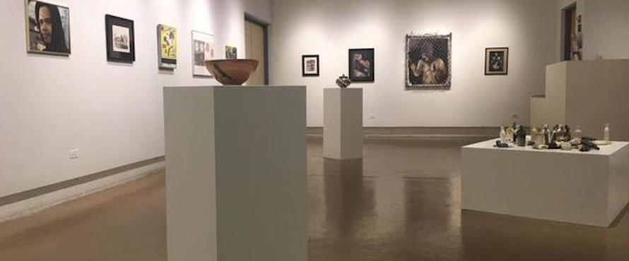 The Fine Arts Center Gallery space with art on the walls and pedestals