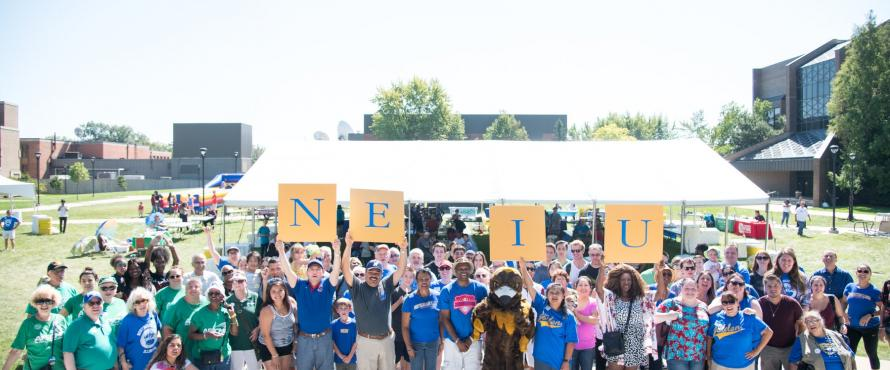NEIU Weekend guests assembled on the University Commons for a group photo