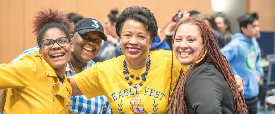 President Gloria Gibson poses with three other people at Eagle Fest