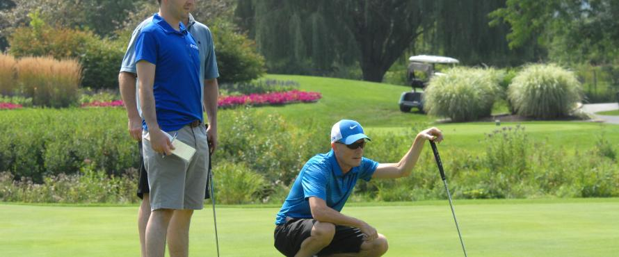 John G. Findley lines up a putt at the Chuck Kane Scholarship Golf Event on Aug. 18, 2014.
