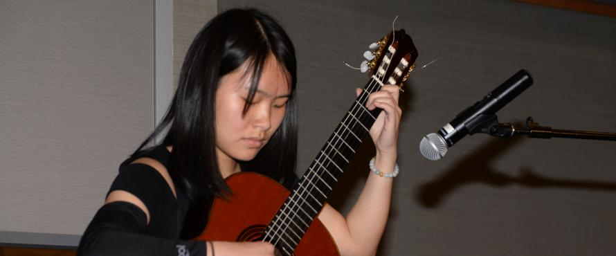 Xiaoxuan Wu performs performs at the fourth annual Scholar-Donor Luncheon on April 14, sponsored by the NEIU Foundation.