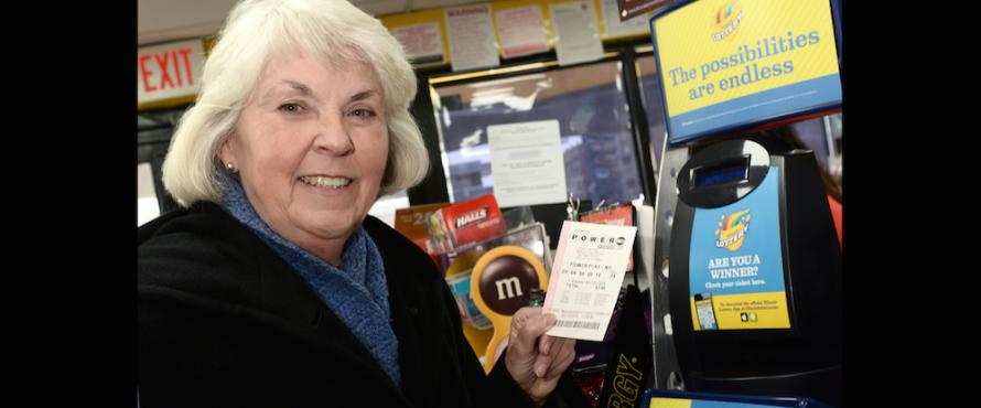 President Sharon Hahs purchases a Powerball ticket.