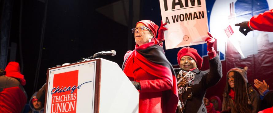 Chicago Teachers Union President Karen Lewis standing at a lectern