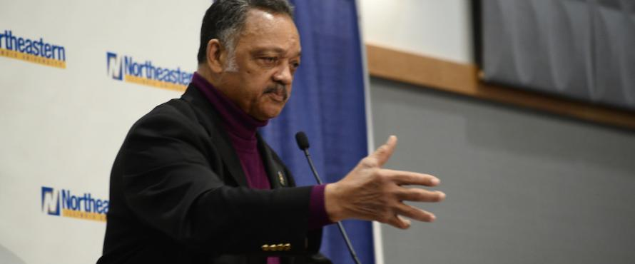 Rev. Jesse Jackson Sr. speaking from a lectern