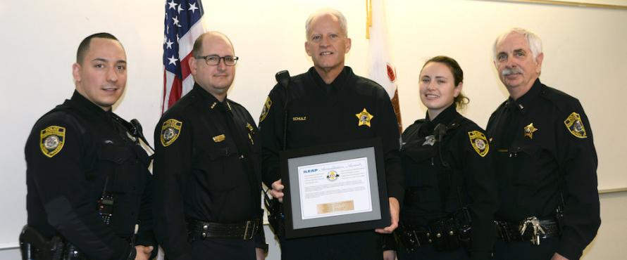 Officer Alvin Lopez (from left), Chief James Lyon, Sgt. John Schulz, Officer Alina Ignatoff and Lt. Paul Kruszynski hold the University Police Department's Illinois Law Enforcement Accreditation Program award.