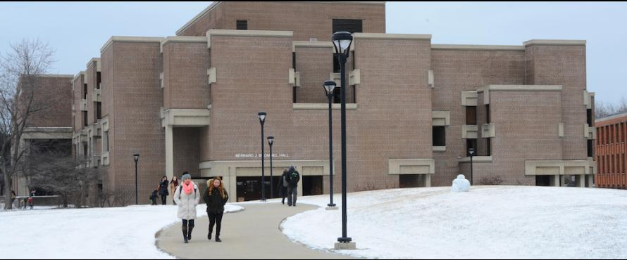 Students walk across the Commons in winter