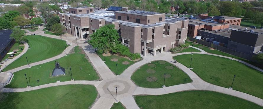 Aerial view of Bernard Brommel Hall with Chicago skyline on the horizon