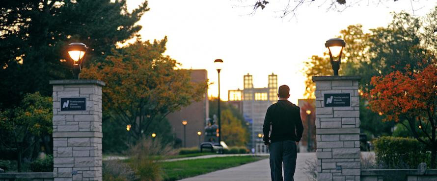 A student walks toward the Main Campus.