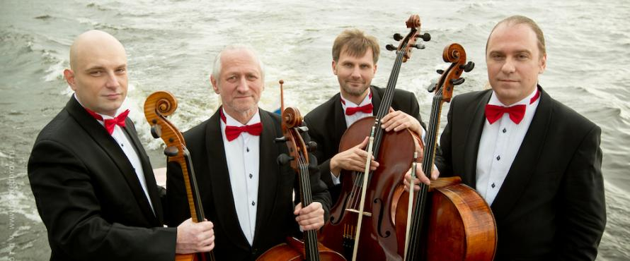 Rastrelli Cello Quartet wearing black tuxedos with red bow ties, each is holding a cello