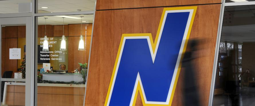 Northeastern's Flying N logo at the entrance of the Office of Enrollment Services