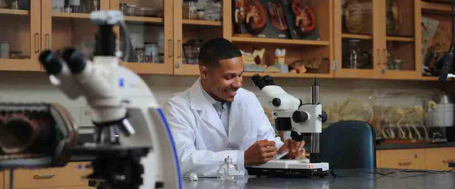 Biology major and McNair Scholar Anthony Smith works in the lab.